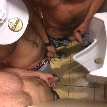 Guys pissing together